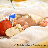 Premature infant in incubator